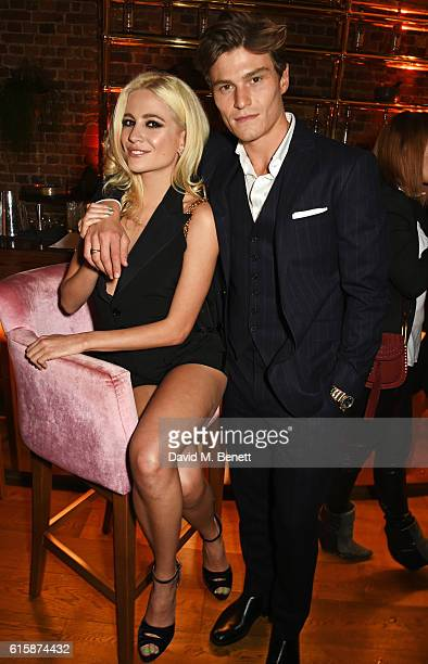 Pixie Lott and Oliver Cheshire attend the Tatler Little Black Book party with Polo Ralph Lauren at Restaurant Ours on October 20, 2016 in London,...
