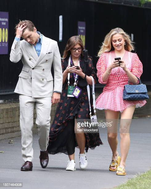 Pixie Lott and Oliver Cheshire attend Wimbledon Championships Tennis Tournament Day 9 at All England Lawn Tennis and Croquet Club on July 07, 2021 in...