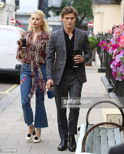 Pixie Lott and Oliver Cheshire seen arriving at Theatre Royal Haymarket for her performance in Breakfast at Tiffany's on July 7 2016 in London England