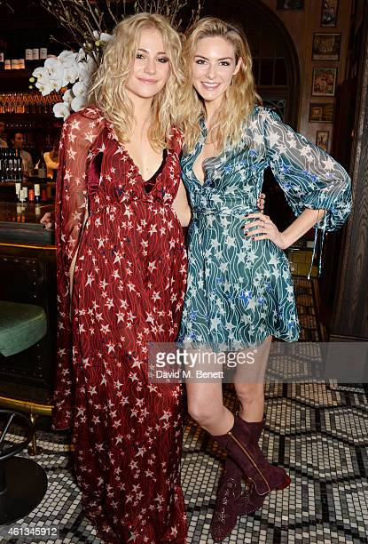 Pixie Lott and Tamsin Egerton attend a dinner hosted by designer Tommy Hilfiger and Dylan Jones editorinchief of British GQ to celebrate London...