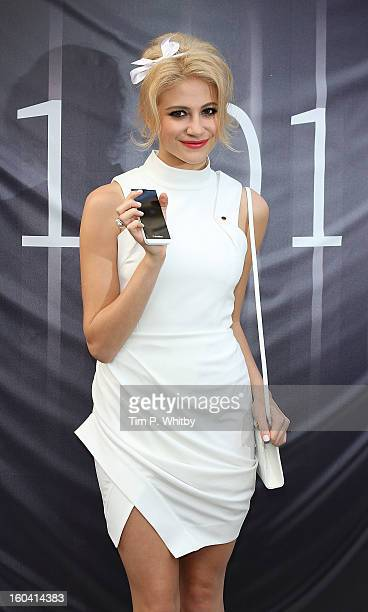 Pixie Lott attends a photocall to launch the new BlackBerry Z10 smartphone at Phones4u Oxford Street on January 31 2013 in London England