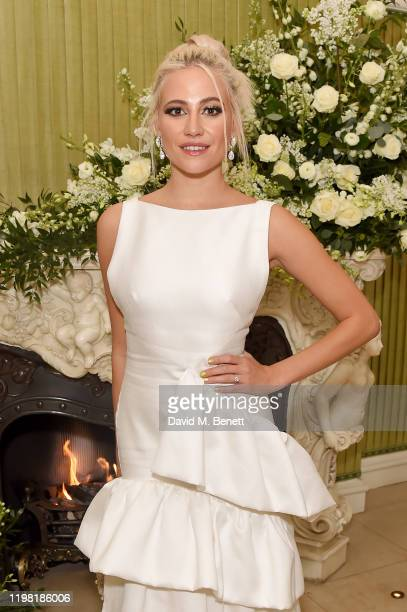 Pixie Lott attends the British Vogue and Tiffany Co Fashion and Film Party at Annabel's on February 2 2020 in London England