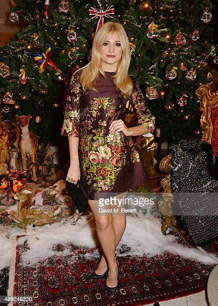 Pixie Lott attends the Claridge's Dolce and Gabbana Christmas Tree party at Claridge's Hotel on November 19 2014 in London England