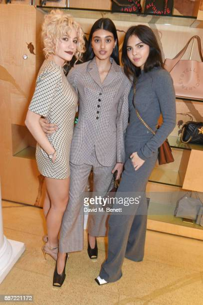 Pixie Lott Neelam Gill and Doina Ciobanu attend the Stella McCartney Christmas Lights 2017 party on December 6 2017 in London England
