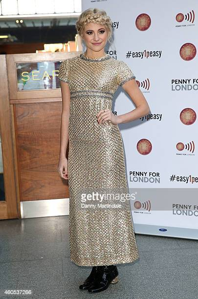 Pixie Lott performs in aid of Penny For London at St Pancras Station on December 16 2014 in London England