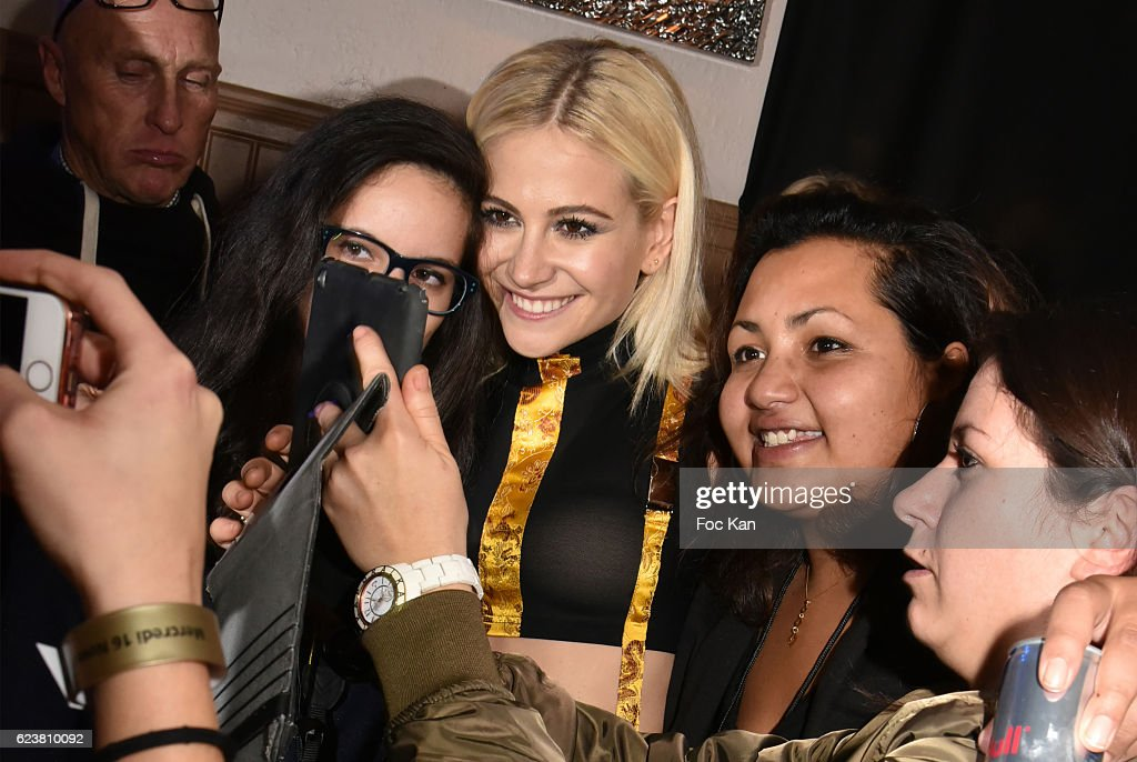 Pixie Lott poses for a selfie with her fans during 'Hard Rock Cafe Paris 25th Anniversary Celebration' at Hard Rock Cafe on November 16, 2016 in Paris, France.