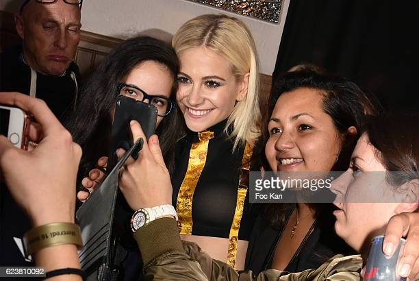 Pixie Lott poses for a selfie with her fans during 'Hard Rock Cafe Paris 25th Anniversary Celebration' at Hard Rock Cafe on November 16 2016 in Paris...