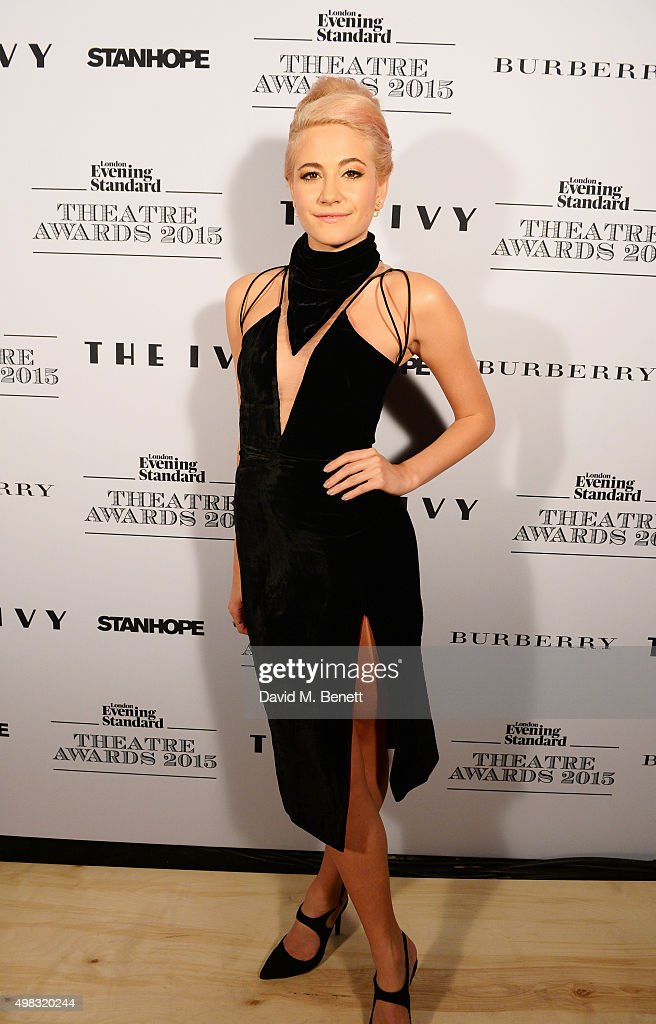 Pixie Lott poses in front of the Winners Boards after performing at The London Evening Standard Theatre Awards in partnership with The Ivy at The Old Vic Theatre on November 22, 2015 in London, England.