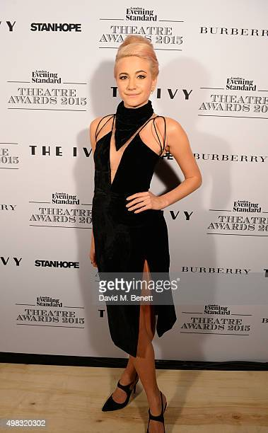 Pixie Lott poses in front of the Winners Boards after performing at The London Evening Standard Theatre Awards in partnership with The Ivy at The Old...