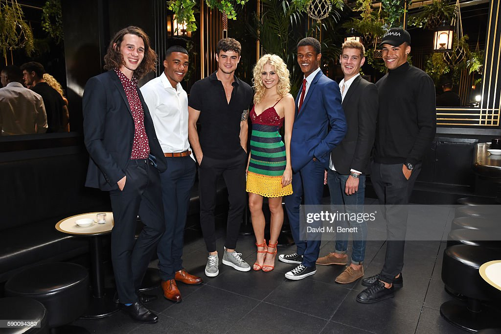 Pixie Lott (C) poses with models Liam Gardner, Kemar Cummins, Christian Arno Williams, O'Shea Robertson, Rob Knighton and Omari Dixon at the launch of her limited edition track 'A Real Good Thing' with Select Model Management at Tramp on August 16, 2016 in London, England.