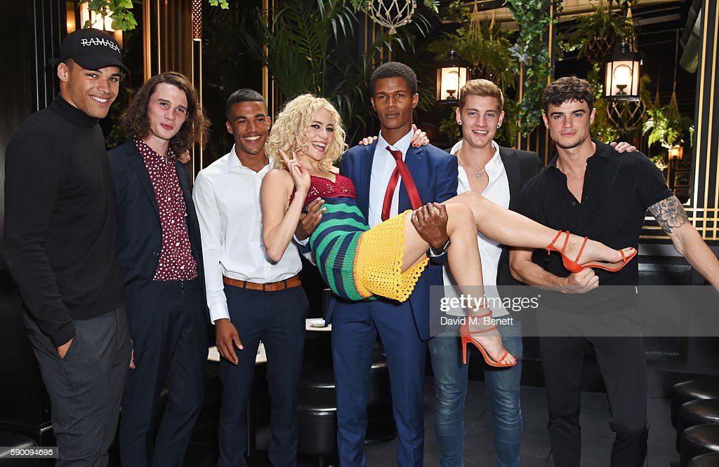 Pixie Lott (C) poses with models Omari Dixon, Liam Gardner, Kemar Cummins, O'Shea Robertson, Rob Knighton and Christian Arno Williams at the launch of her limited edition track 'A Real Good Thing' with Select Model Management at Tramp on August 16, 2016 in London, England.