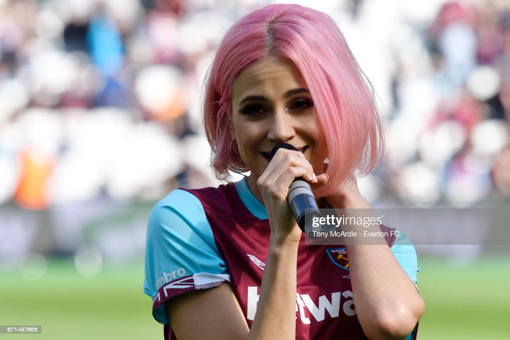Pixie Lott sings to the at half time during the Premier League match between West Ham United and Everton at London Stadium on April 22, 2017 in Stratford, United Kingdom.