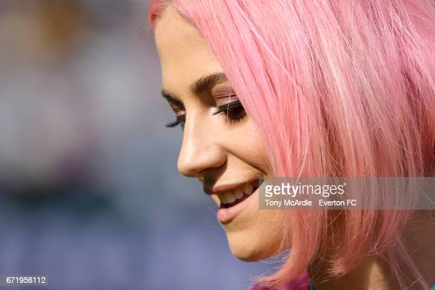 Pixie Lott sings to the fans at half time during the Premier League match between West Ham United and Everton at London Stadium on April 22 2017 in...