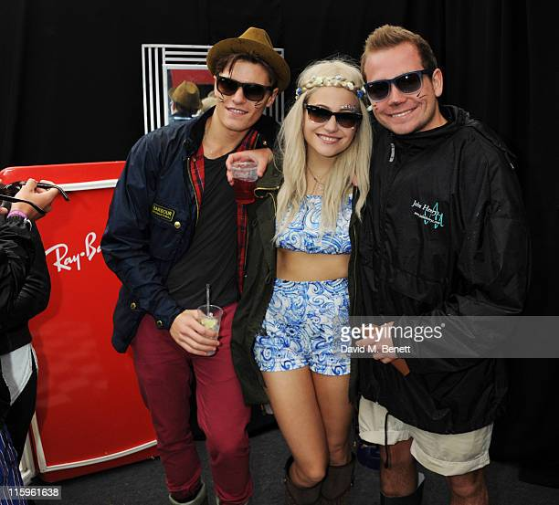 Pixie Lott Steve Lott and Oliver Cheshire attend the RayBan Rooms during day three of the Isle of Wight Festival 2011 at Seaclose Park on June 12...