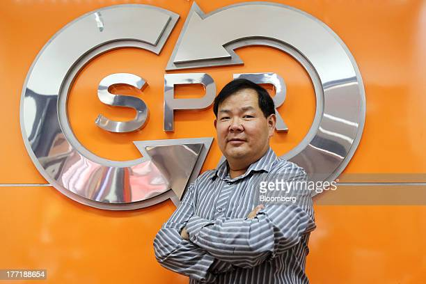 Piya Tanticachyanon managing director of Super Rich 1965 Co poses for a photograph at one of the company's currency exchange branches in Bangkok...