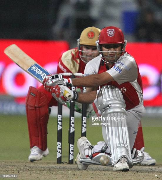 AFRICA MAY 01 Piyush Chawla of India and the Kings XI Punjab attempts a reverse sweep shot off Anil Kumble as South African wicketkeeper Mark Boucher...