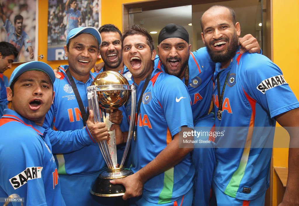 Piyush Chawla (L),Virender Sehwag (2L),Zaheer Khan (3L),Suresh Raina (3R),Harbhajan Singh (2R) and Yusuf Pathan (R) pose with the world cup trophy in the players dressing room after their six wicket victory in the 2011 ICC World Cup Final between India and Sri Lanka at Wankhede Stadium on April 2, 2011 in Mumbai, India.