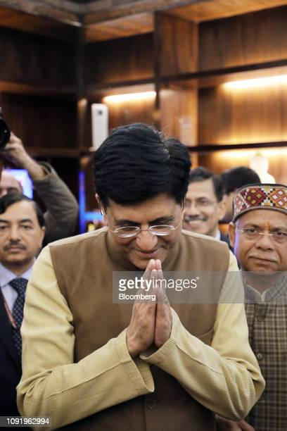 Piyush Goyal India's interim finance minister center greets members of the media with his budget team at North Block in New Delhi India on Thursday...