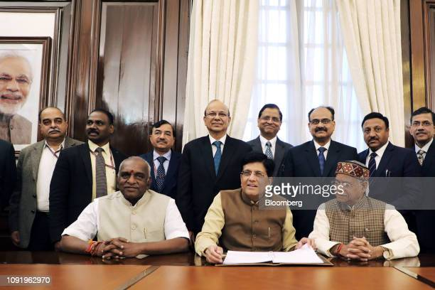 Piyush Goyal India's interim finance minister center poses for a photograph with his budget team at North Block in New Delhi India on Thursday Jan 31...