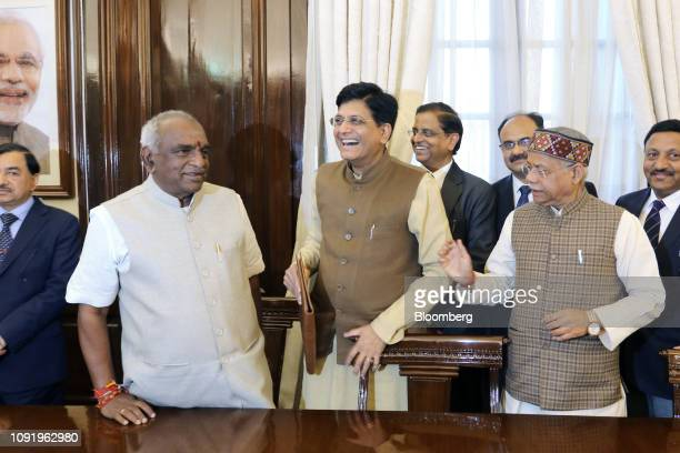 Piyush Goyal India's interim finance minister center reacts while standing with his budget team at North Block in New Delhi India on Thursday Jan 31...