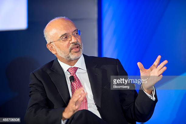 Piyush Gupta chief executive officer of DBS Group Holdings Ltd gestures as he speaks at the Milken Institute Asia Summit in Singapore on Friday Sept...