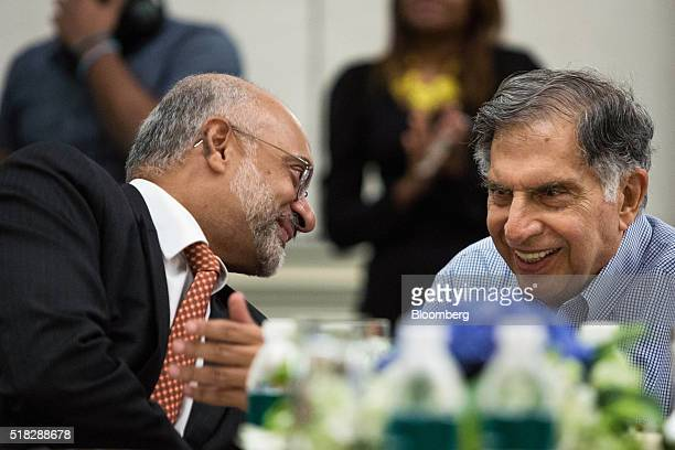 Piyush Gupta chief executive officer of DBS Group Holdings Ltd left speaks to Ratan Tata chairman emeritus of Tata Sons during a session advising...