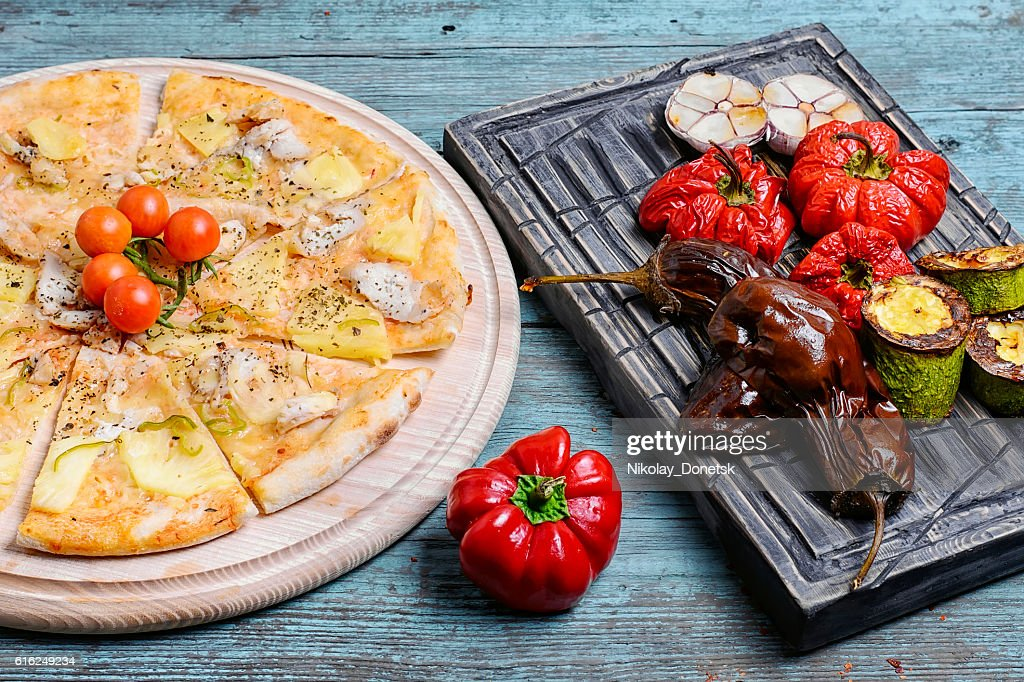 pizza and baked vegetables : Foto de stock