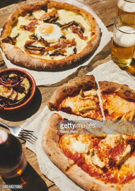 Pizza And Beer In An Outdoor Setting