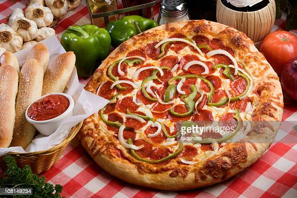 pizza and breadsticks - green bell pepper stock pictures, royalty-free photos & images