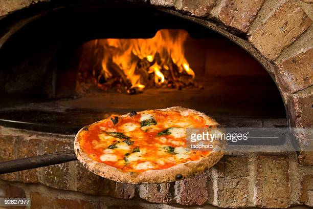 pizza and brick oven - pizza oven stock photos and pictures