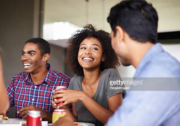 pizza and laughs - man eating woman out stock photos and pictures