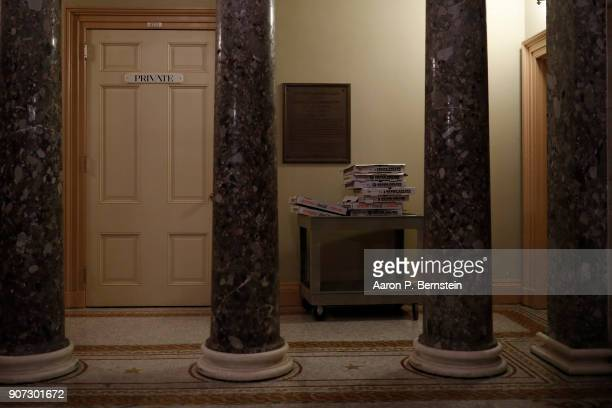 Pizza boxes are seen outside the offices of Senate Majority Leader Mitch McConnell as legislators work into the night to avert a government shutdown...