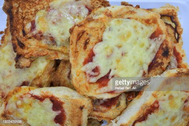 pizza bread with cheese and tomato - rafael ben ari stock-fotos und bilder