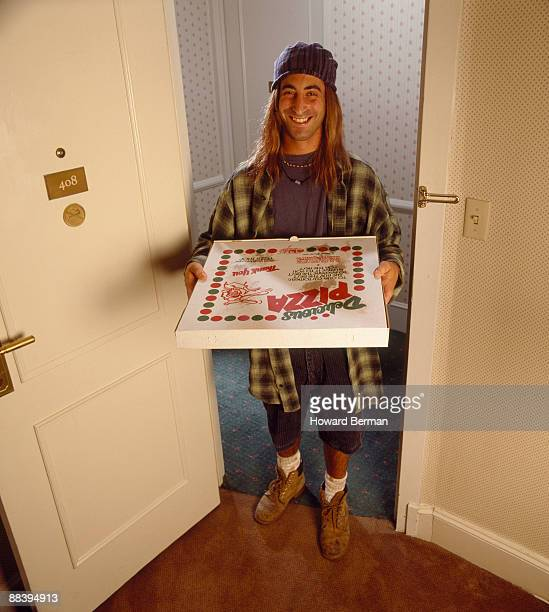 Pizza Delivery Boy in Doorway