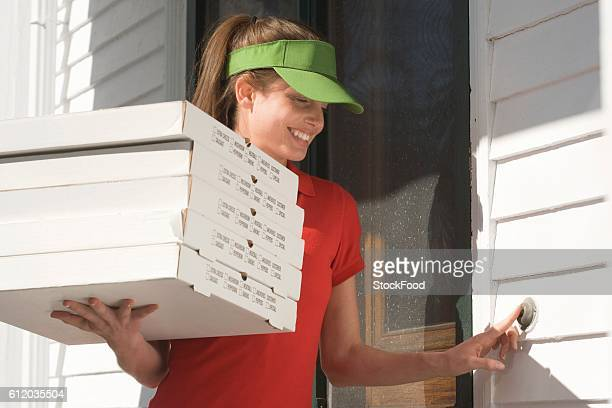 Pizza delivery girl ringing doorbell