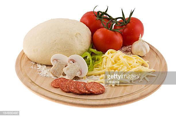 Pizza dough with fresh tomatoes, mushrooms and cheese