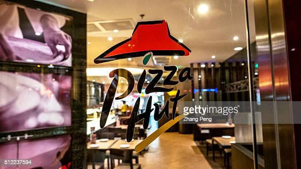 Pizza Hut logo on the window of a Pizza Hut restaurant Pizza Hut makes up 25% of Yum Brands restaurants in China Pizza Hut reported a 2% sales growth...