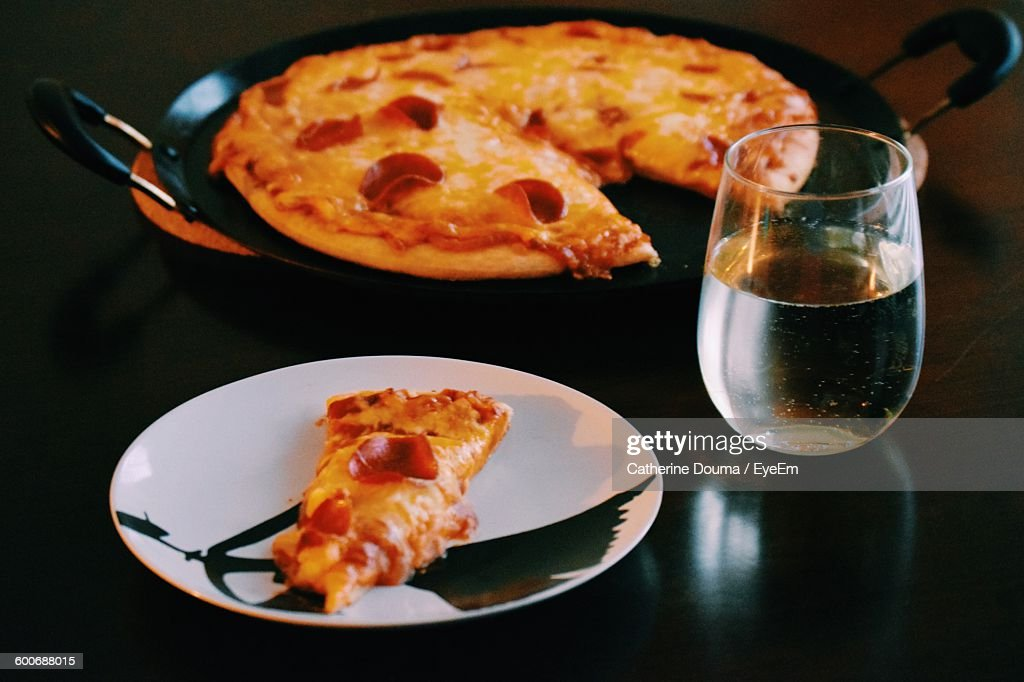 Pizza In Plate By White Wine On Table High Res Stock Photo Getty
