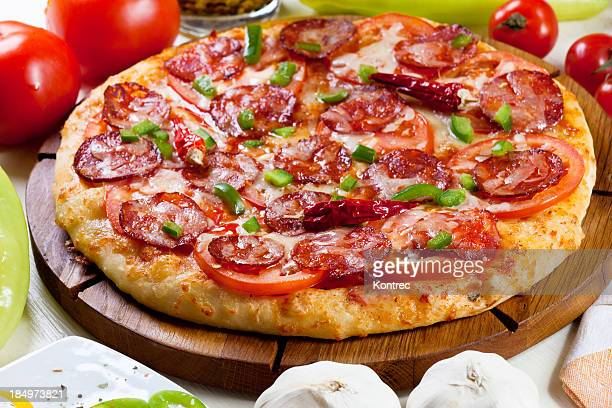 pizza inferno - pepperoni stock photos and pictures