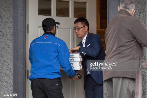 Pizza is delivered to the residence of Huawei Technologies Chief Financial Officer Meng Wanzhou after she was released on bail in Vancouver British...