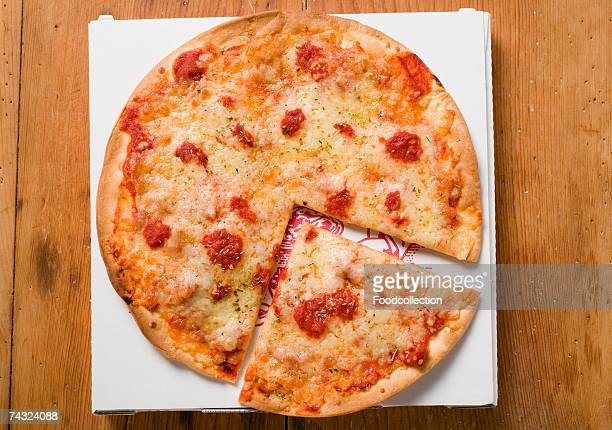 pizza margherita, a slice cut, on pizza box - cheese pizza stock photos and pictures