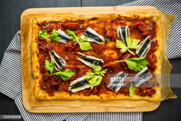 pizza marinara garnished with anchovies and parsley - flat leaf parsley stock pictures, royalty-free photos & images