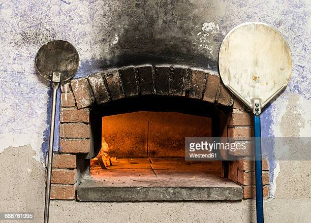 pizza oven and peels - pizza oven stock photos and pictures