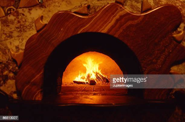 pizza oven with fire - pizza oven stock photos and pictures