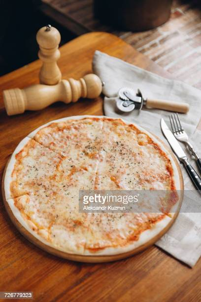 pizza pie on table - cheese pizza stock photos and pictures