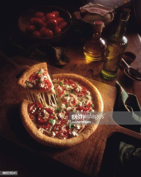 Pizza pull on table of ingredients