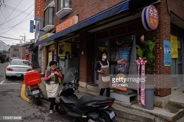 Pizza restaurant owner Eom Hangki walks outisde her restaurant 'Sky Pizza' in Seoul on February 13 2020 Locations featured in the South Korea's...