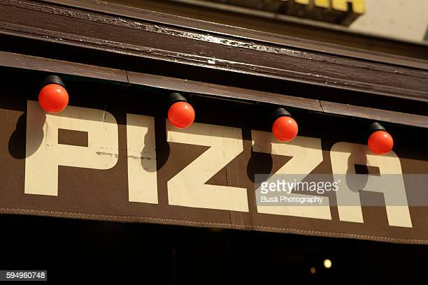 pizza restaurant sign with red light bulbs in berlin, germany - pizzeria stock photos and pictures