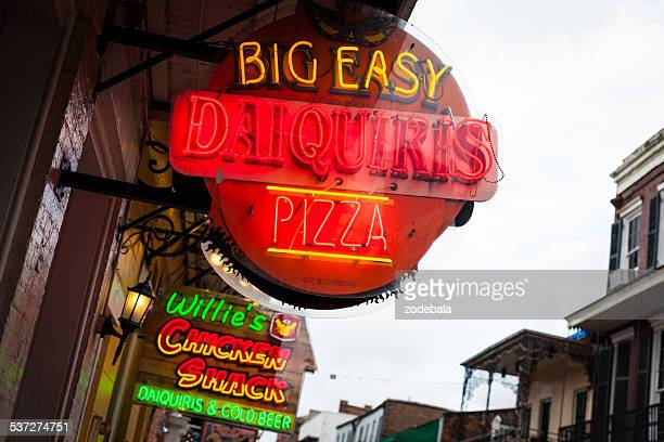 pizza sign in bourbon street, new orleans, usa - french quarter stock photos and pictures
