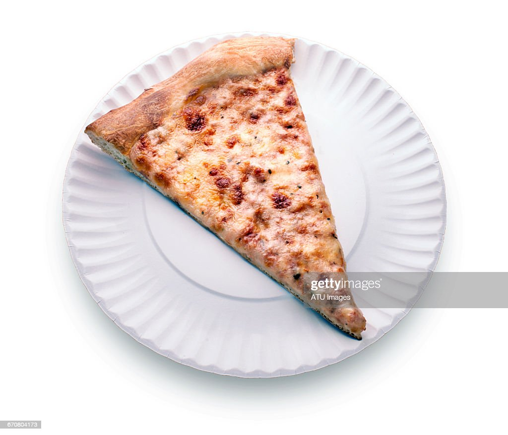 pizza slice on paper plate : Stock Photo